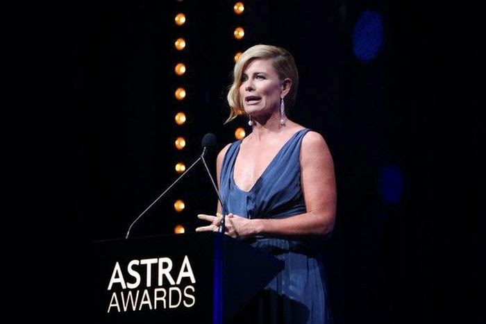 In favorite theme of dress design and color, Deborah Hutton speaks so beauty on the Astra Award stage at Sydney, Australia on Thursday, March 20, 2014.