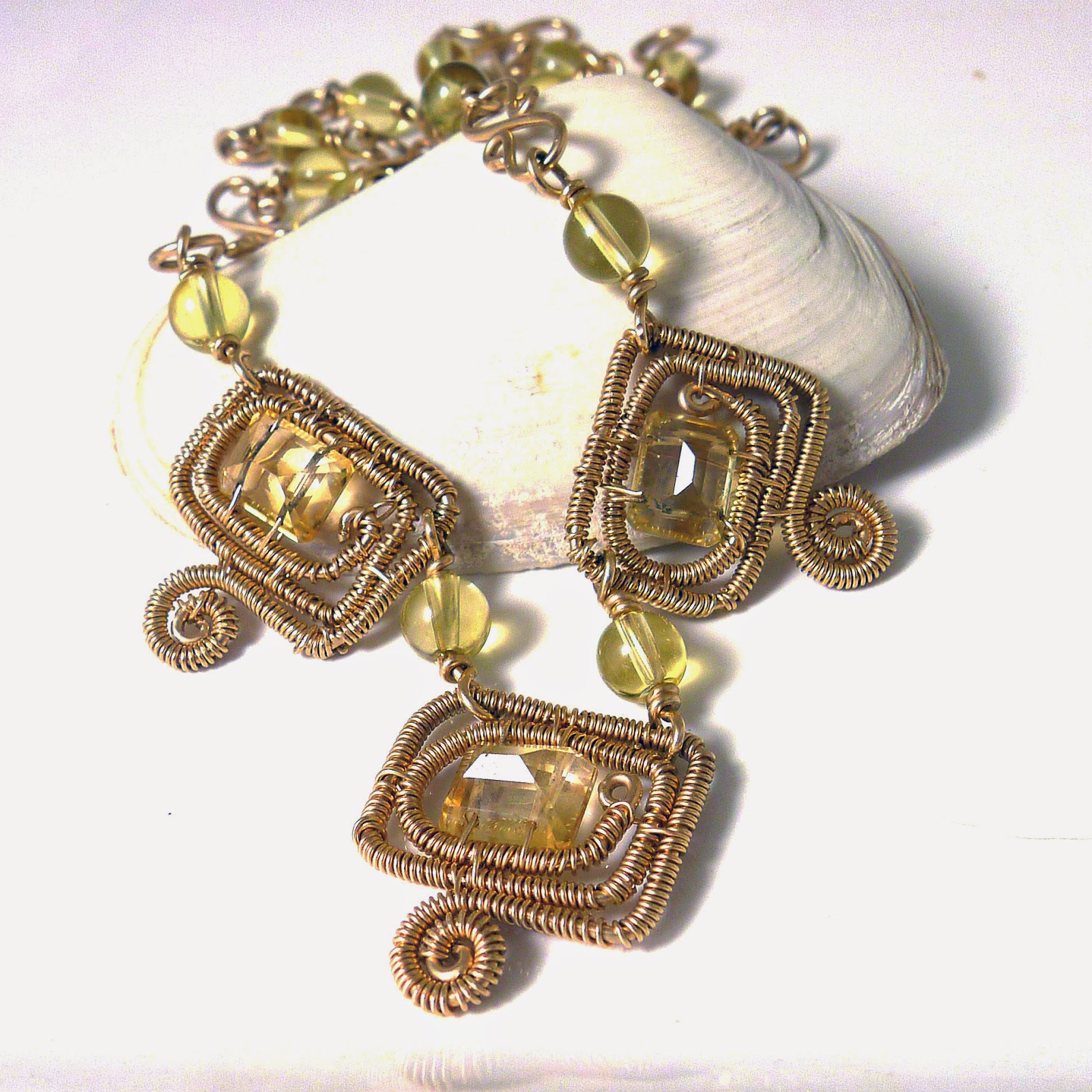 http://www.shazzabethcreations.co.nz/#!product/prd1/2536451321/citrine-and-topaz-14k-gold-motif-necklace