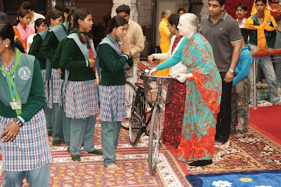 Jagadguru Kripaluji Maharaj giving bikes to girl students