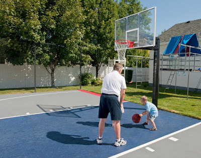 Father and son on a basketball court at home