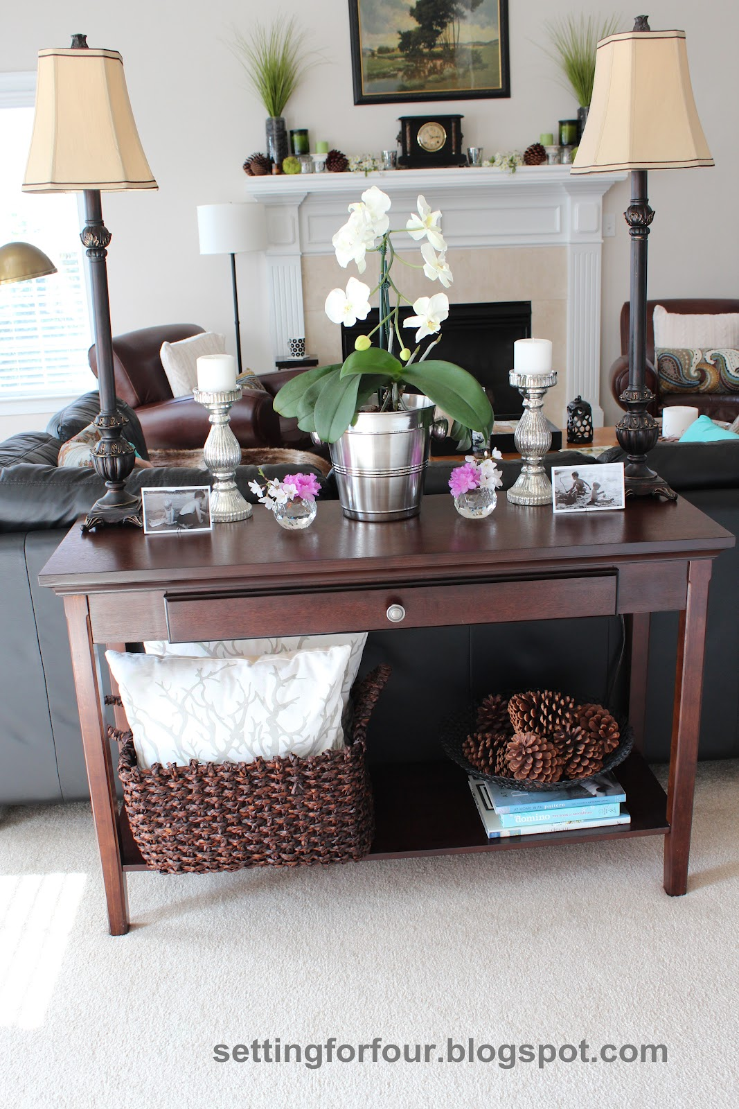 Styling a sofa table setting for four for Living room sofa table decorating