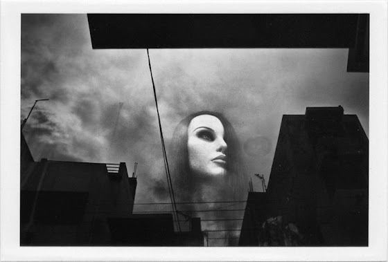 dirty photos - et - a black and white photo of shop window manequin reflection