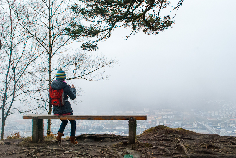 Girl taking a photograph of the view on mount floyen