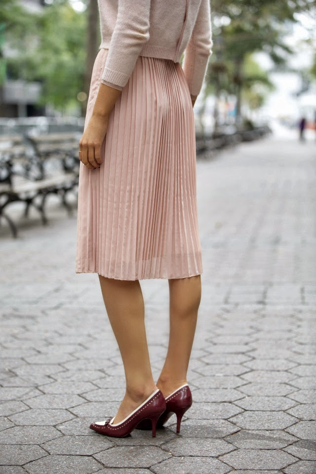 pastel pleated skirt crop sweater top karen walker super duper tory burch pumps