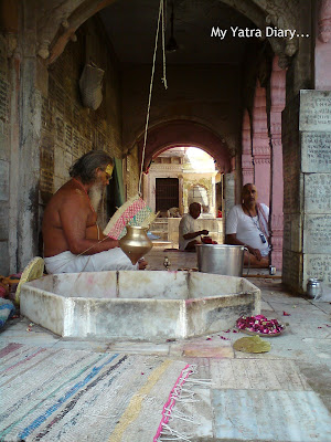 A priest praying at the Yamuna River Ghat, Mathura