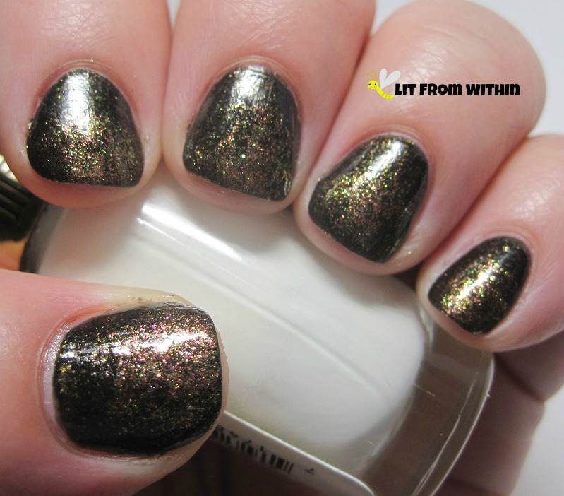 Cover Girl Seared Bronze, a pink/bronze polish with some of the same green/gold duochrome glitters as Black Heat