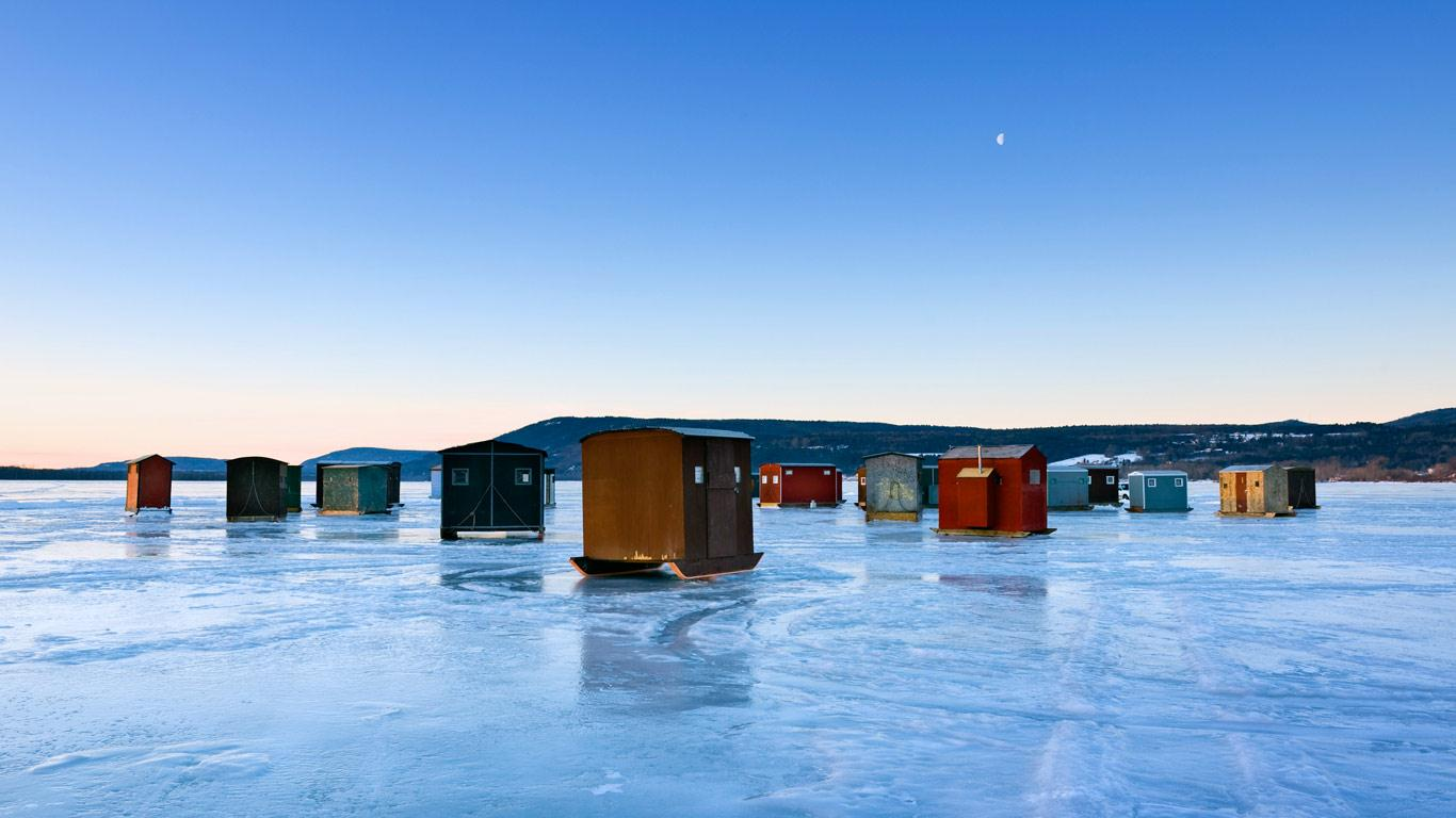 Ice fishing huts on frozen lake in new york state usa for Ice fishing ny