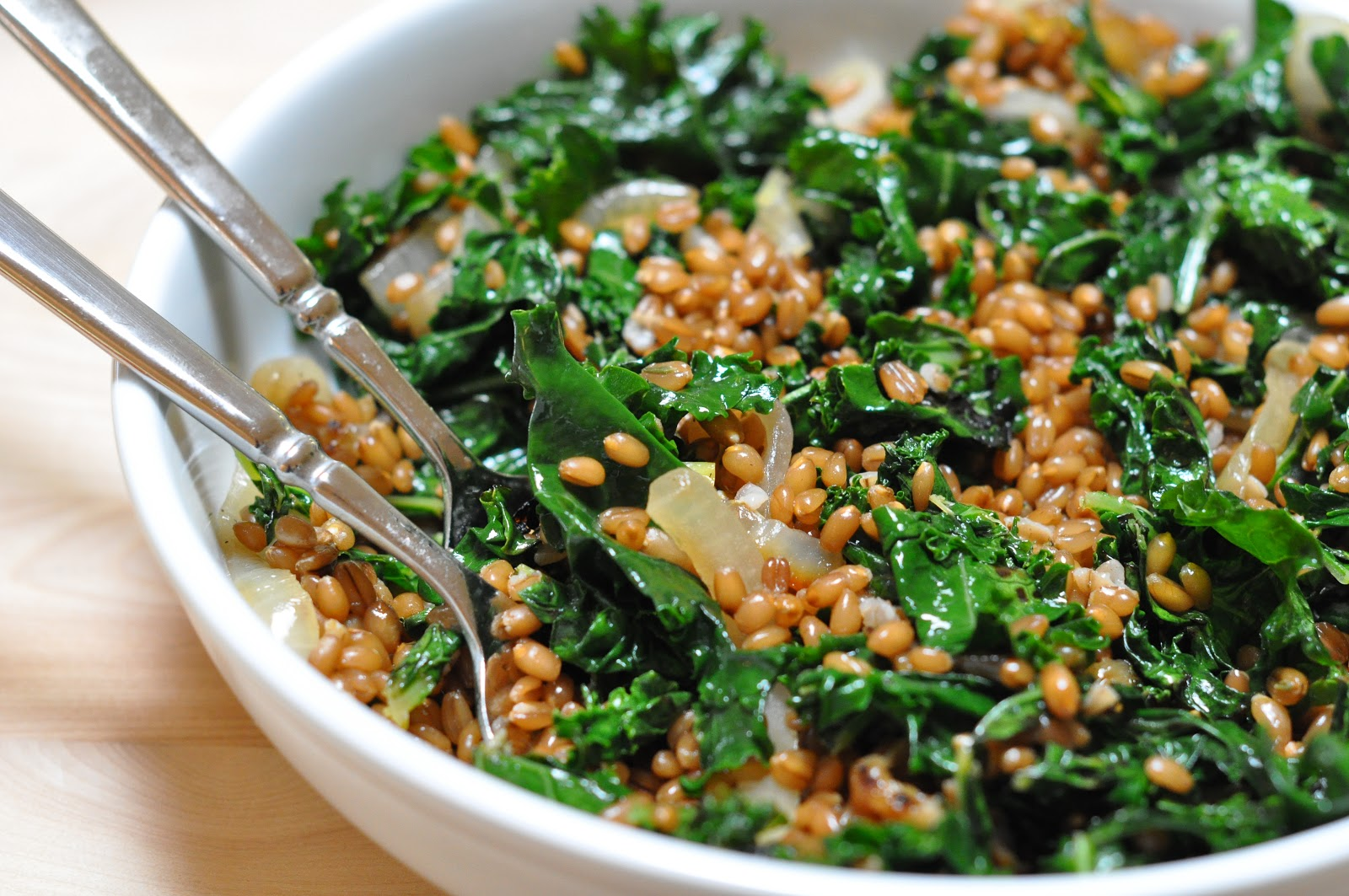 ... with herb salsa verde , wheat berries with charred onions and kale