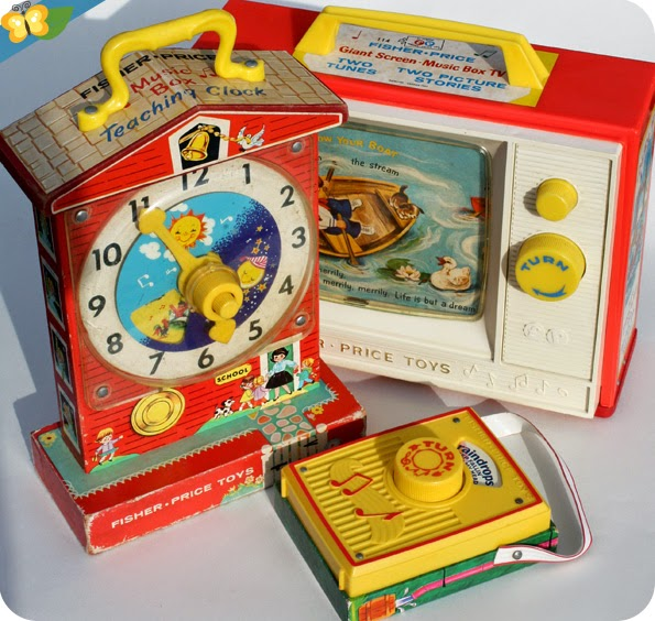 la Teaching Clock, le Giant screen - Music Box TV et la Pocket radio de Fisher-Price