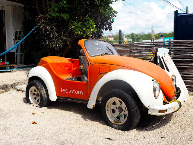 Bright orange mini bug car in Tulum, Mexico