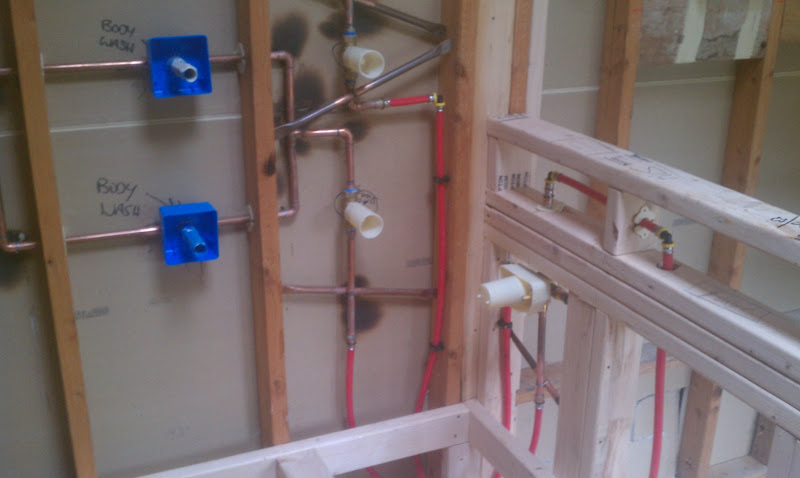 Plumbing rough in for body washes and rain head feature. title=