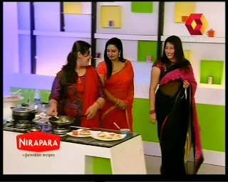 Lakshmi Nair and Sona Nair hot navel show in saree from Kairali TV