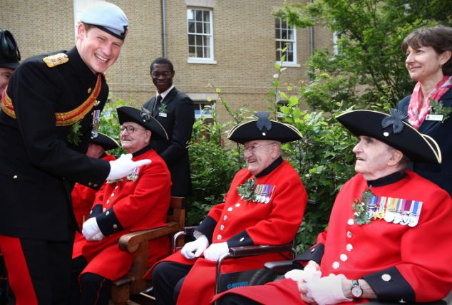 So when are you getting married? Chelsea pensioner, 85, makes Prince Harry blush as Harry replies 'Not for a long time'