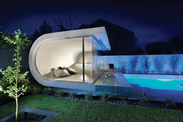 Modern pool house by the pool at night
