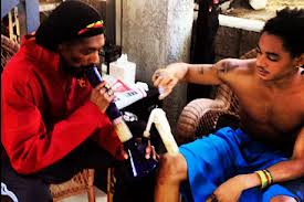 Snoop Lion Labeled As Bad Role Model For Smoking Marijuana With His Son