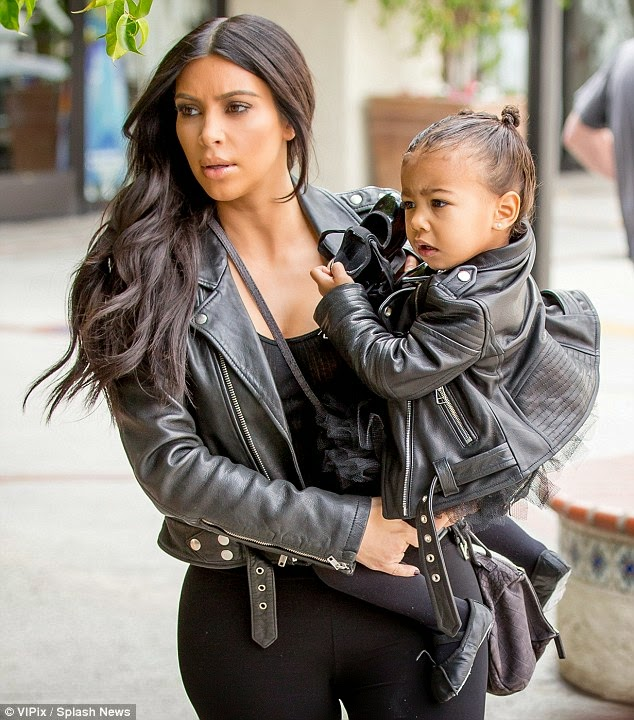 Stunning!! Kim Kardashian steps out with North West in her 'wedding day jacket' (Photos) 1