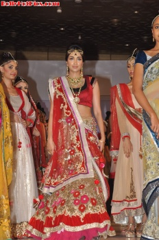 jiah Khan looking stunning in a red dress and gold jewelery  - Jiah Khan Ramp Walk at Indian Fashion Street 2012