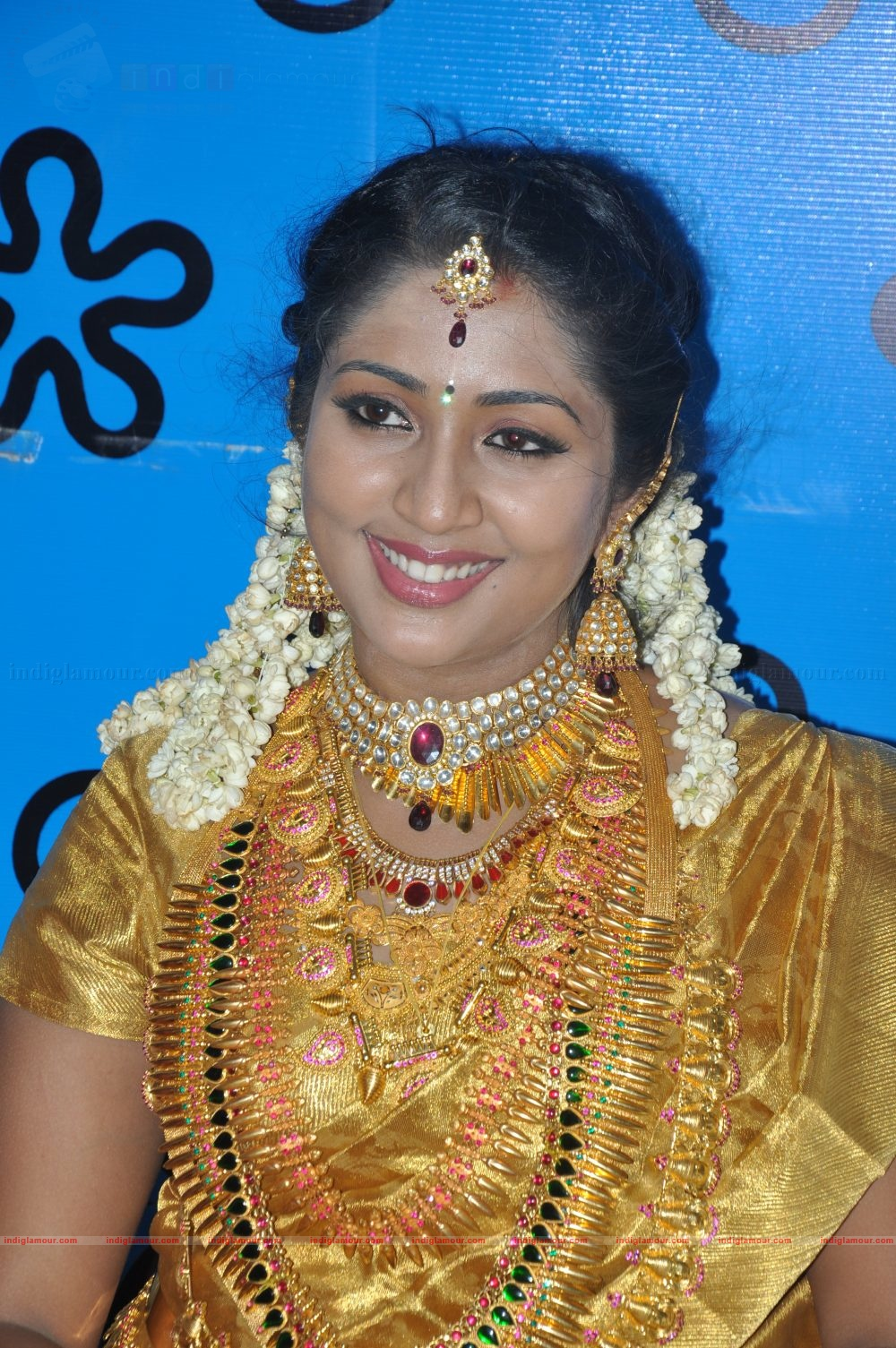 Marriage ornaments - Actress Navya Nair Wedding Jewellery Collections
