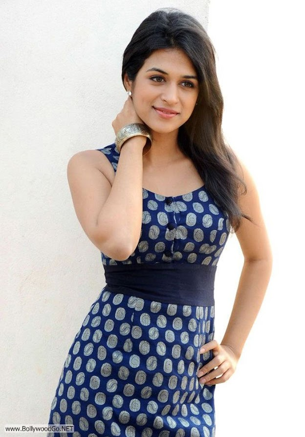 Shradha das lifts her arms to show the underside of her arm - (2) -  Shraddha Das Dark blue dress pics