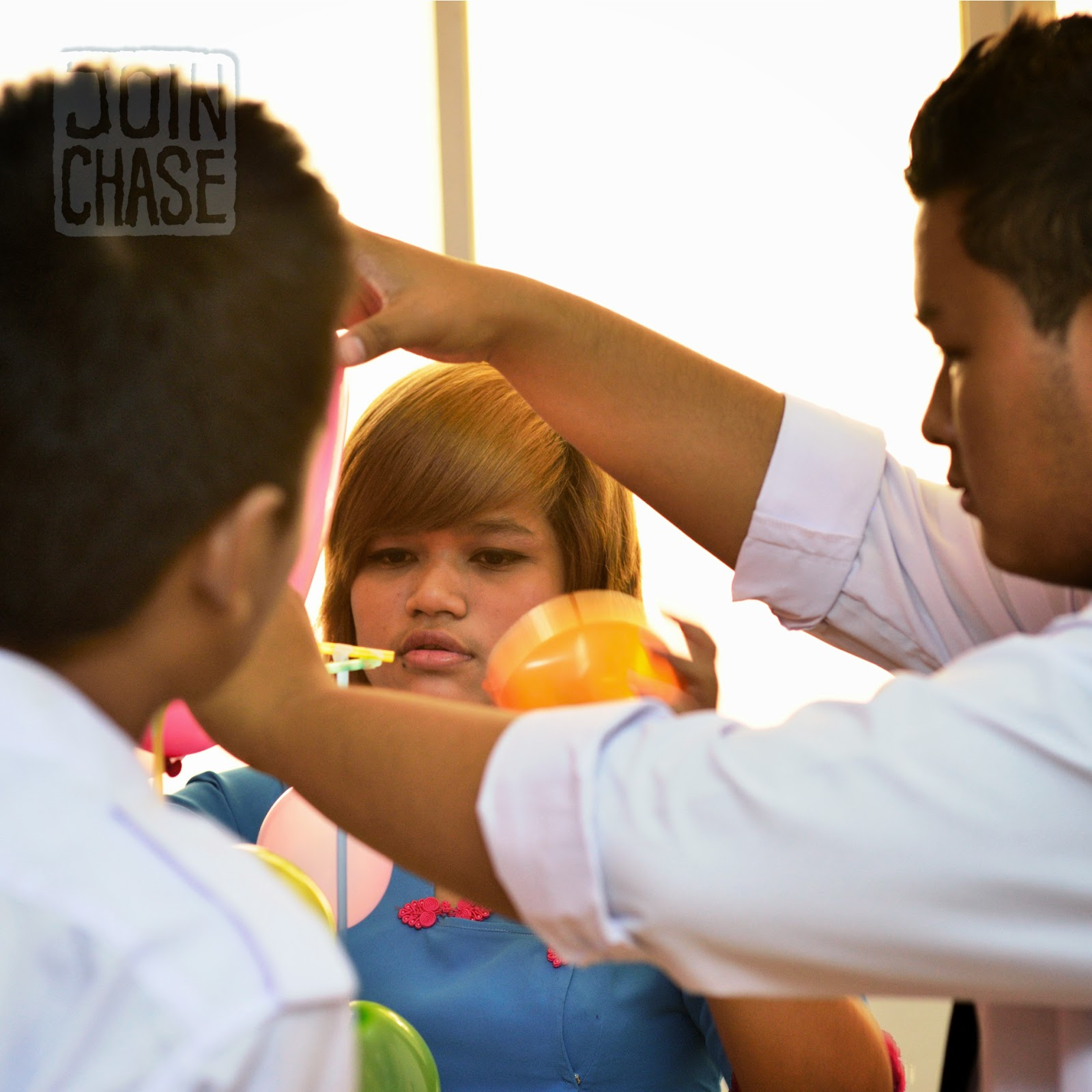 Students in Yangon, Myanmar, building a balloon tower during an English lesson.