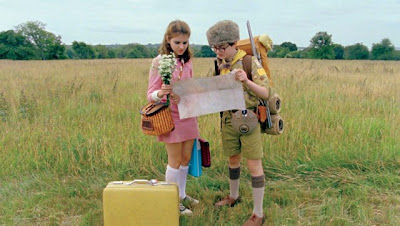 Suzy and Sam in a field in Moonrise Kingdom