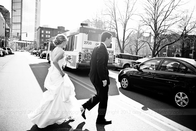bride and groom crossing the street in downtown Indianapolis