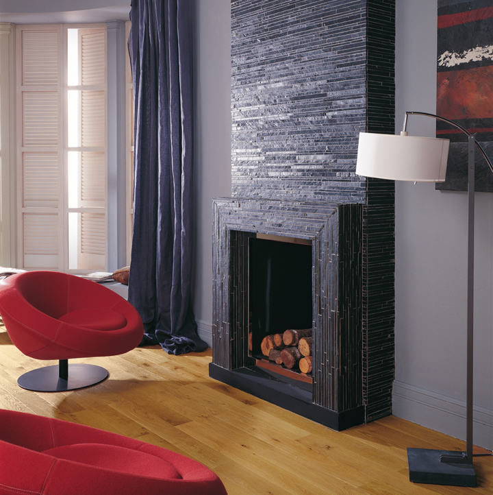 Cozy spaces in the warmth of a fireplace porcelanosa - Revestimiento de chimeneas ...