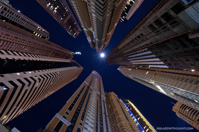 Photo of the skyscrapers in the tallest block of Dubai Marina as seen from the ground looking up at night