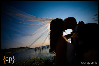 Stephanie and Kalani kiss at Shilshole Bay Beach Club