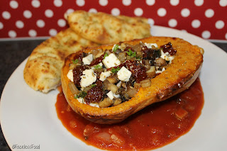 stuffed butternut squash on a plate with garlic bread