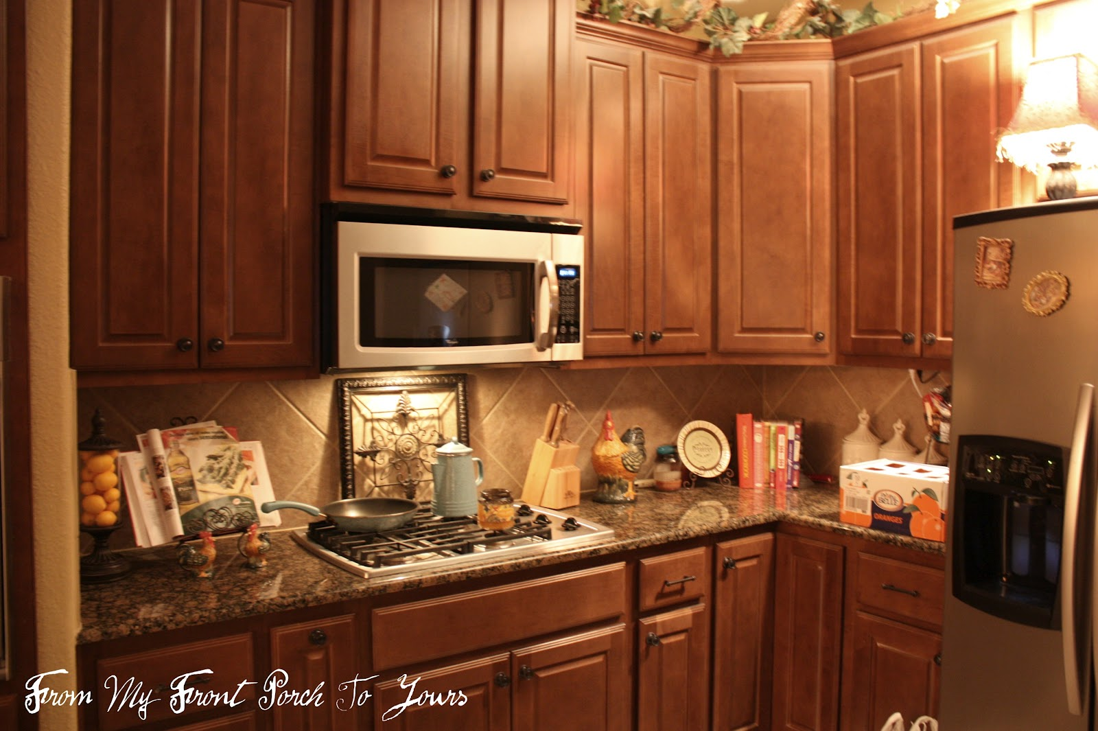Kitchens with Cabinets On Top of the Lights