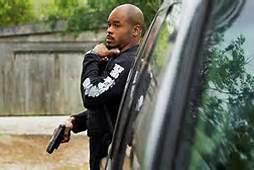 Deputy U.S. Marshall Robert Marshal hunting down a fugitive.