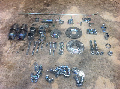 Piezas metálicas de la Impala después del zincado