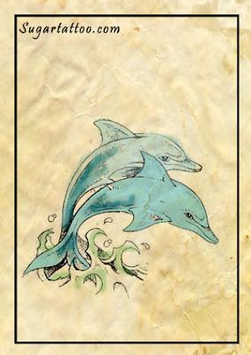 dolphin tattoos,sun tattoos,moon tattoos