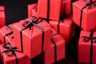 black and red wrapped holiday presents
