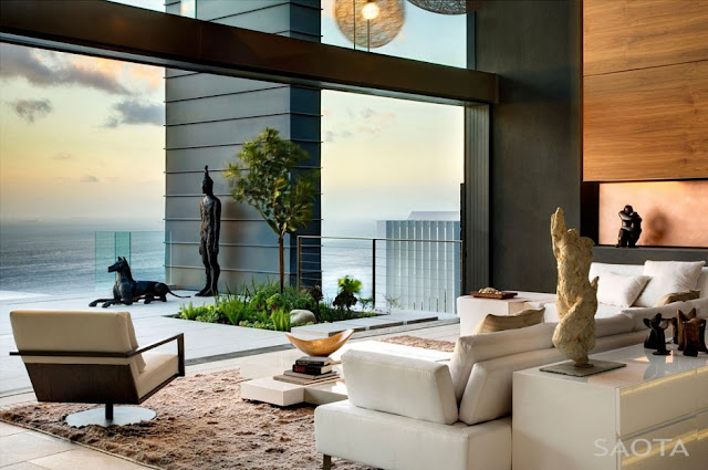 Photo of modern living room interiors at sunset