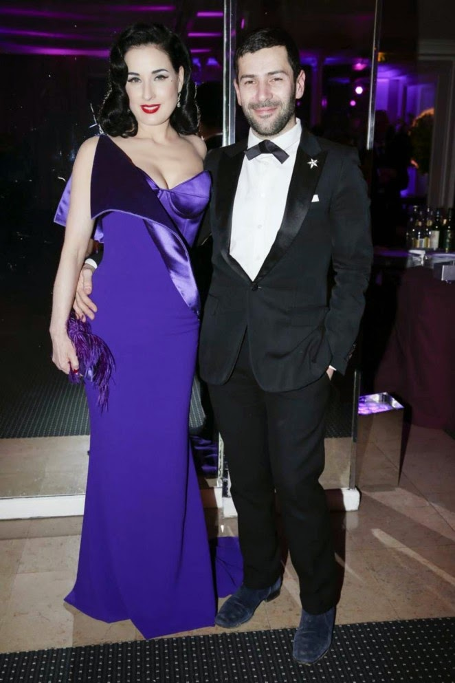 Dita Von Teese in a purple origami dress at the 2015 Sidaction Gala Dinner in Paris