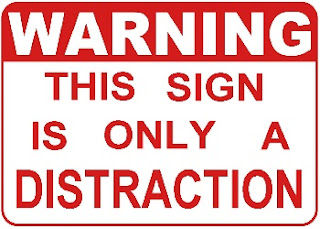 WARNING-_this_sign_is_only_a_distraction_Wallpaper_pcwfi.jpg