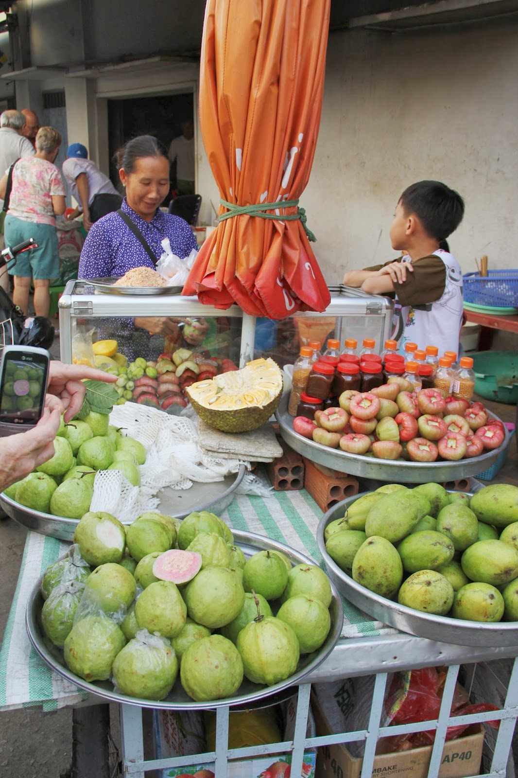 Rose apples (green with pink inside) and jackfruit (yellow hunk in read) at the Chau Doc market.