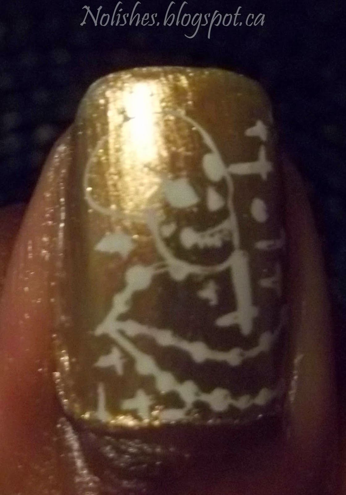 Nail stamping manicure with white Gustav Klimt inspired images (from Moyou London Artist 14) stamped over a gold/pink duochrome base.