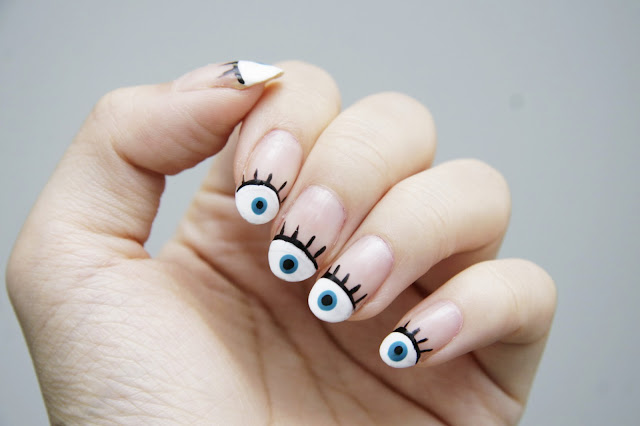 I've been seeing these evil eye nails circulating the internet ... - Fun Size Beauty: #HALLOWEEN - Evil Eye Nail Art