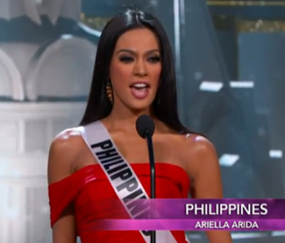 Ariella Arida in a red cocktail dress during the Miss Universe 2013 prelims opening