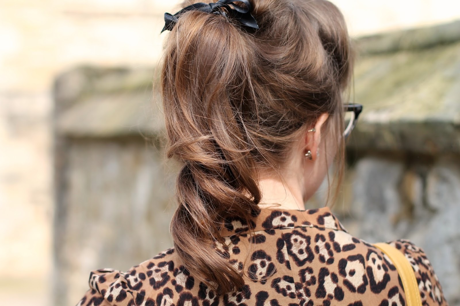 50s style curly ponytail with hair ribbon