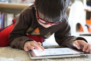 special needs child and an ipad
