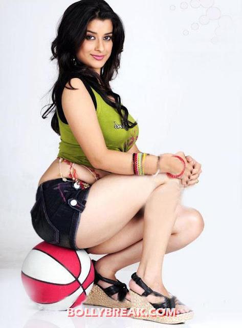 Madhurima posing on basketball - Madhurima Unseen Photos