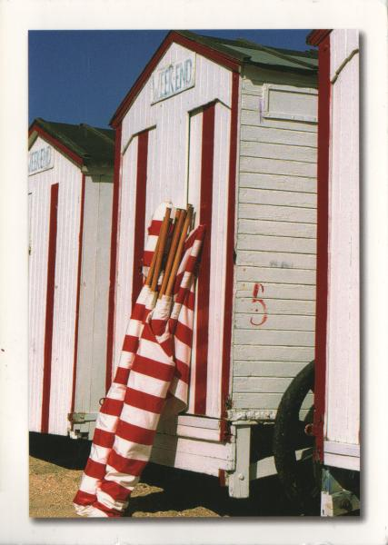 red and white beach huts