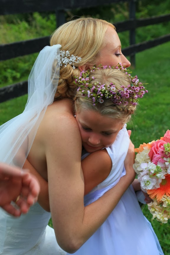 Bluemont Vineyard Bride Hugging Flower Girl