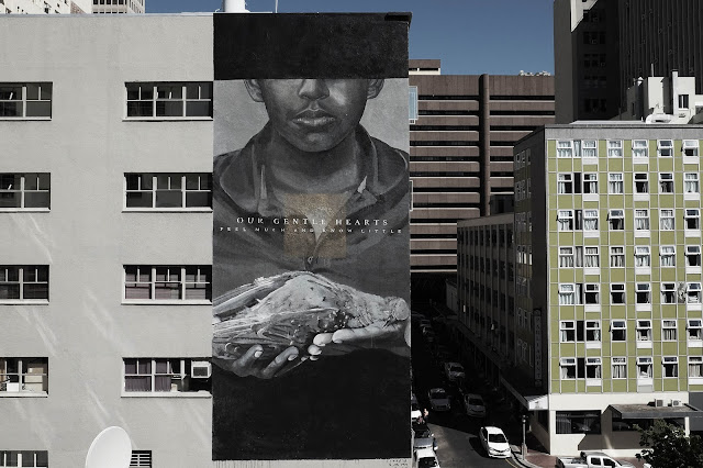 "Our friend Freddy Sam just sent us a series of images from his newest mural ""Our Gentle Hearts"" which was just completed on the streets of Cape Town in South Africa."