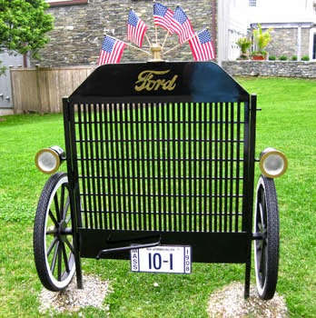 black iron gate shaped like antique auto grille