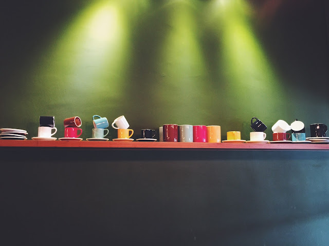 A.R.C Coffee Singapore - Interior Design with Latte Cups